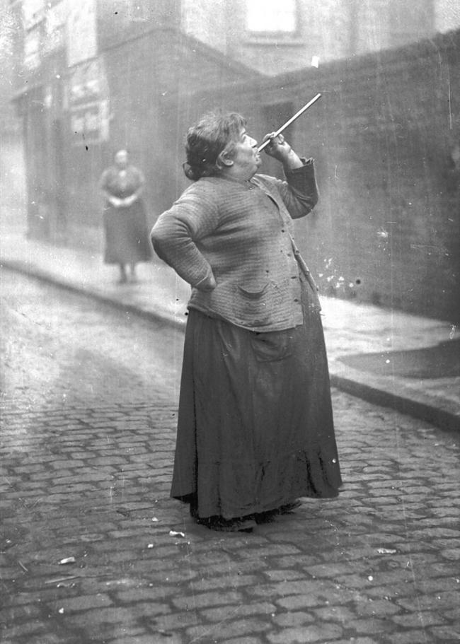 Knocker Up Mary Smith, in the East End wielding a pea shooter by photographer John Topham in 1931