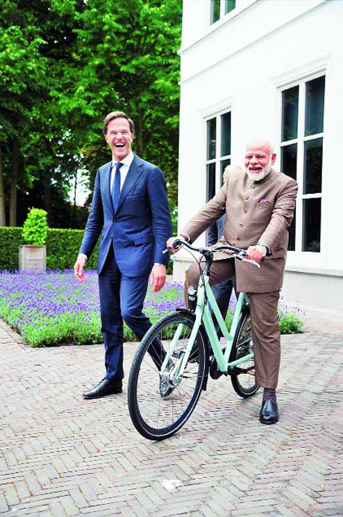 http://www.financialexpress.com/india-news/narendra-modi-gifted-cycle-by-premier-mark-rutte-delighted-pm-takes-to-twitter-shares-photos/738828/