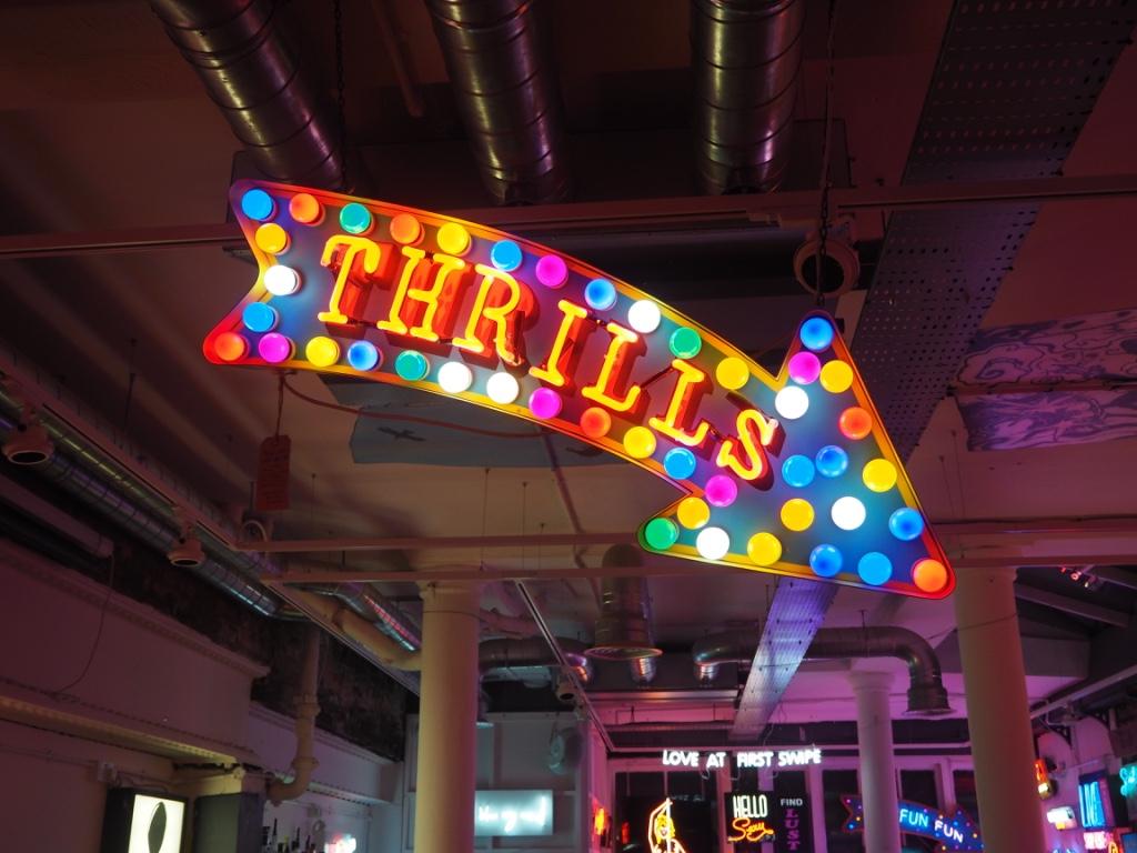 neon signs soho thrills arrow