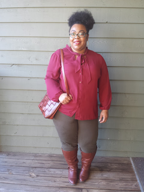 plus size pussy bow blouse, jeggings, and boots