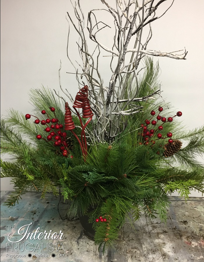 How to make Festive Outdoor Lighted Christmas Planters to flank the front door that don't require watering with artificial greens for DIY holiday decor.