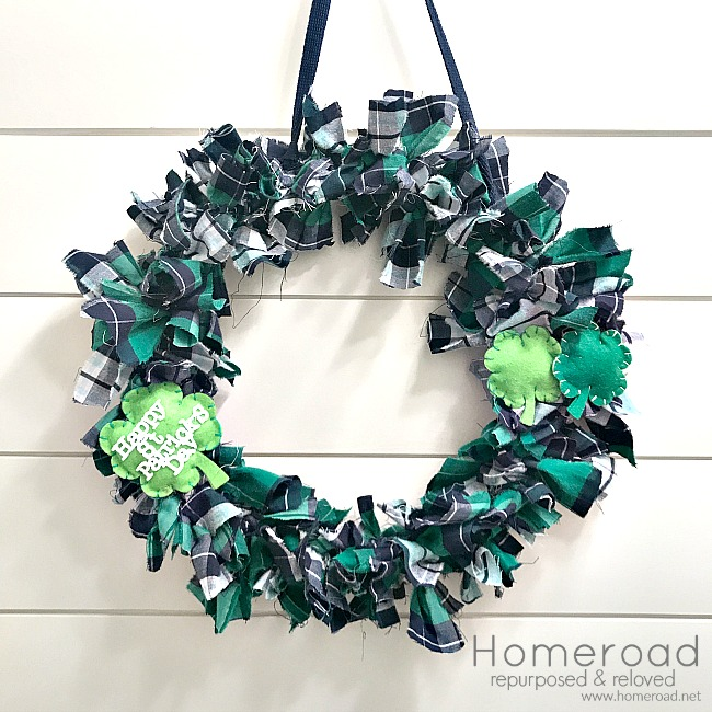 rag wreath on shiplap wall