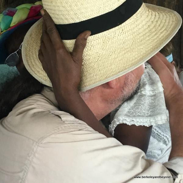 Alison emraces customer at Blue Crab Restaurant in Scarborough, Tobago