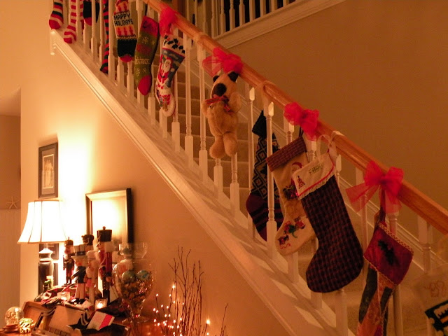 Christmas staircase banister filled with stockings at Chickadee Home Nest