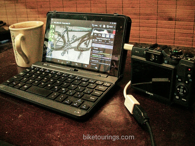 Picture of tablet and camera being used to edit RAW format files