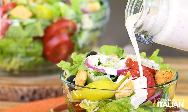 Olive Garden dressing recipe poured over salad