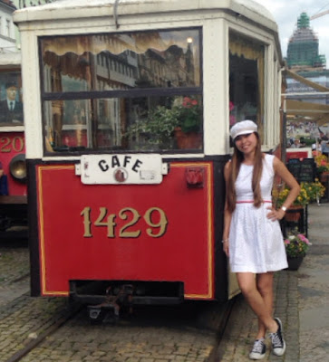 Lady standing beside a tram