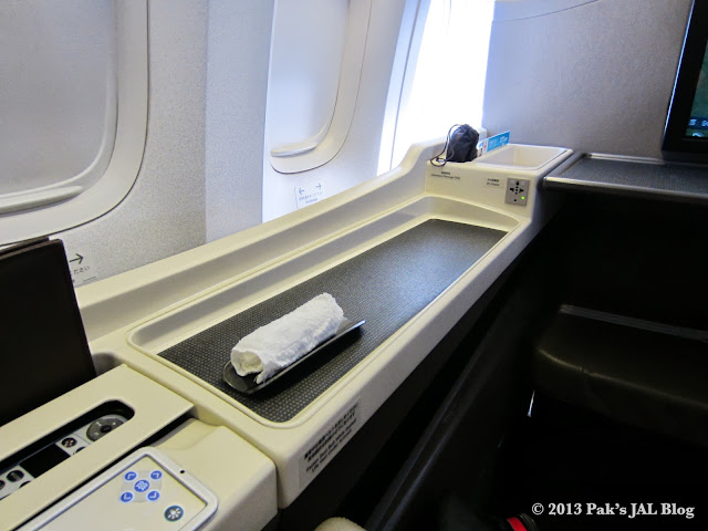 All of the storage compartments are located on the non-aisle side of the seat