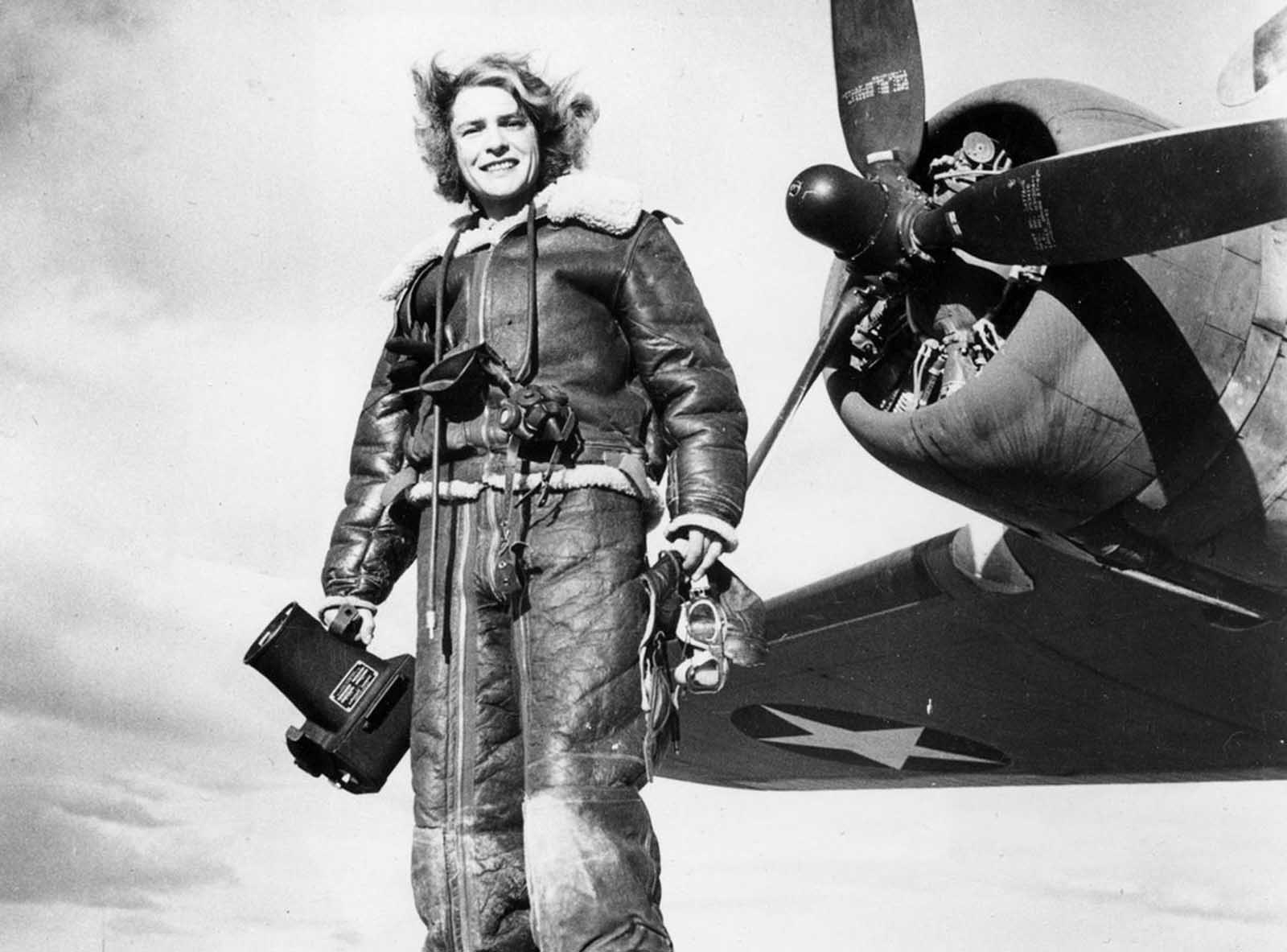 Life magazine photojournalist Margaret Bourke-White wears high-altitude flying gear in front of an Allied Flying Fortress airplane during a World War II assignment in February 1943.