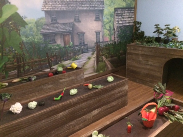 A room set up like a garden with raised vegetable patches