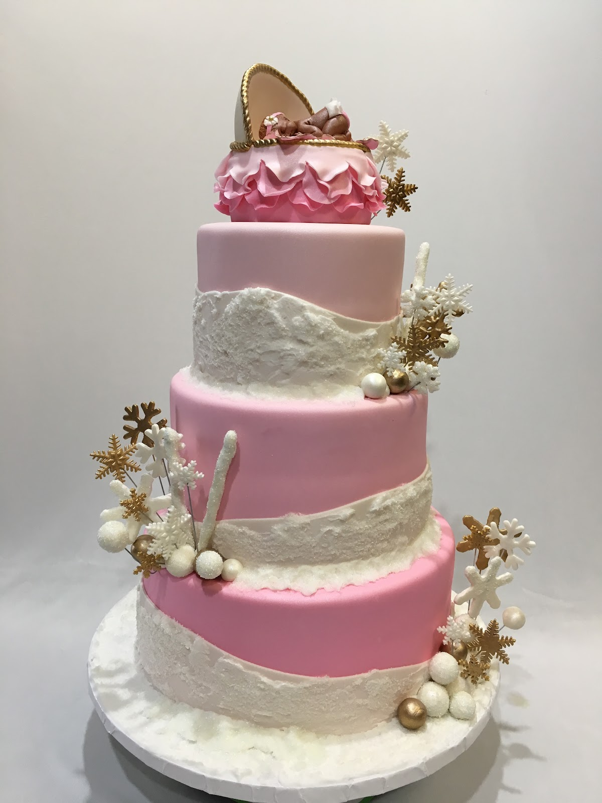 Pink and white Winter Wonderland baby shower cake