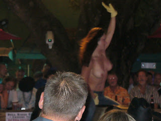 Nude bull riding