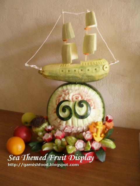 sea theme fruit display with sailing ship carving