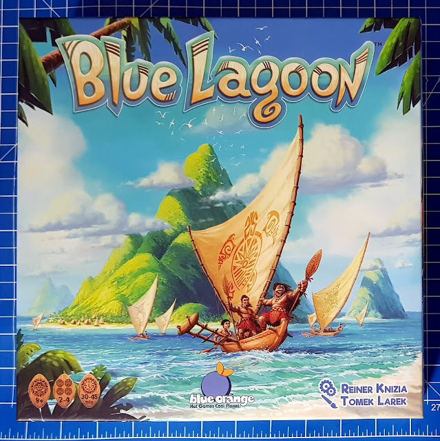 Blue Lagoon Family Game Review box front with pacific style drawing and wooden longboat with native people smiling