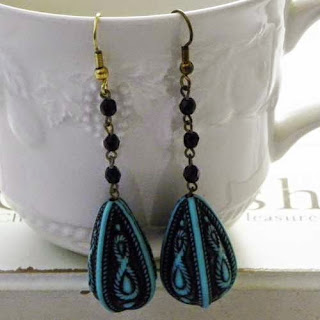 Black and turquoise bead earrings dangling