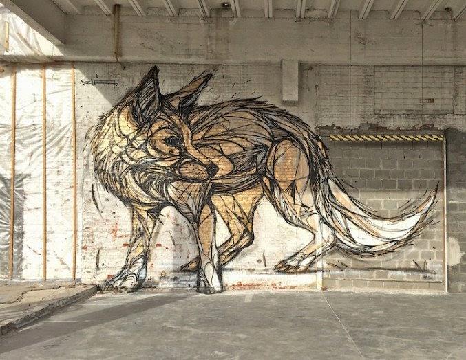 Arte urbano mural de un lobo en la calle