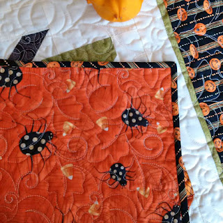 backing for patchwork pumpkin table topper: QuiltBee