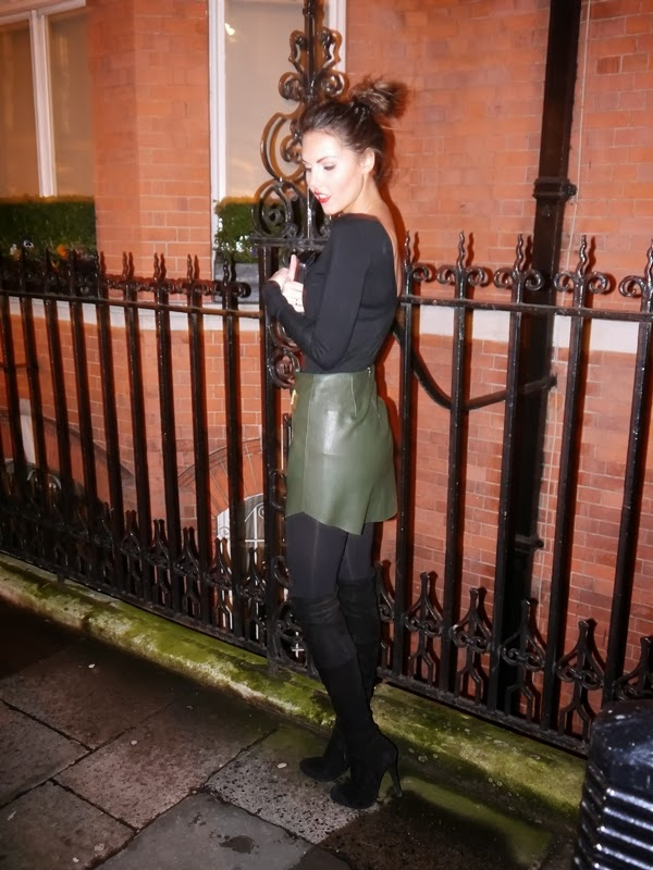 Black sweater and khaki leather skirt in Mayfair