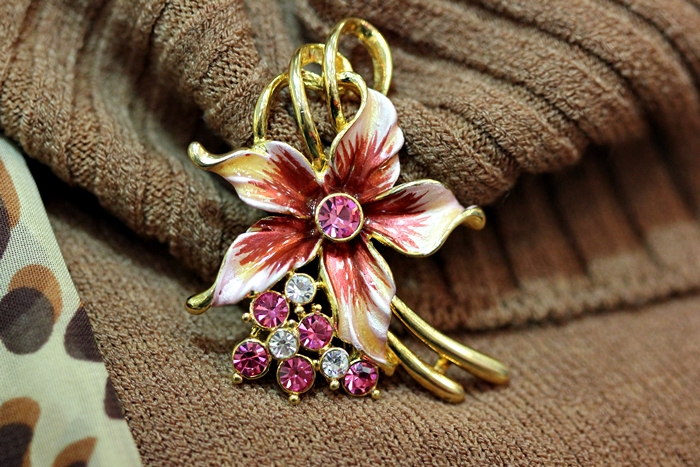 pink flower brooch with small pink crystals