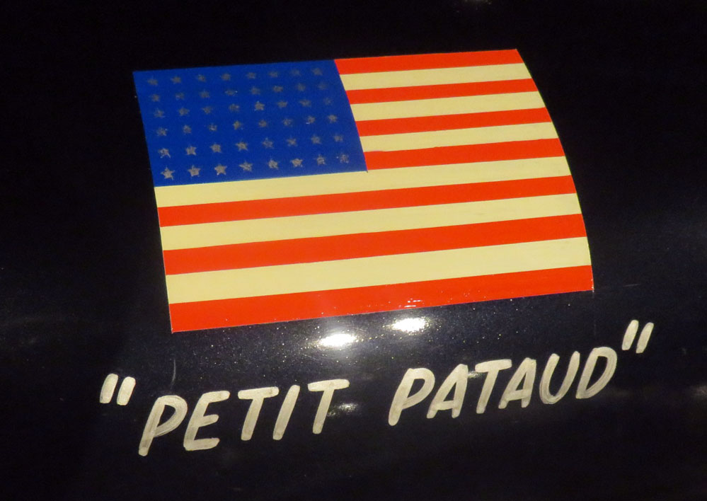 U.S. flag with nickname beneath it.