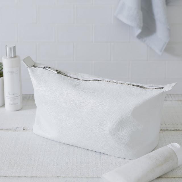 white leather washbag