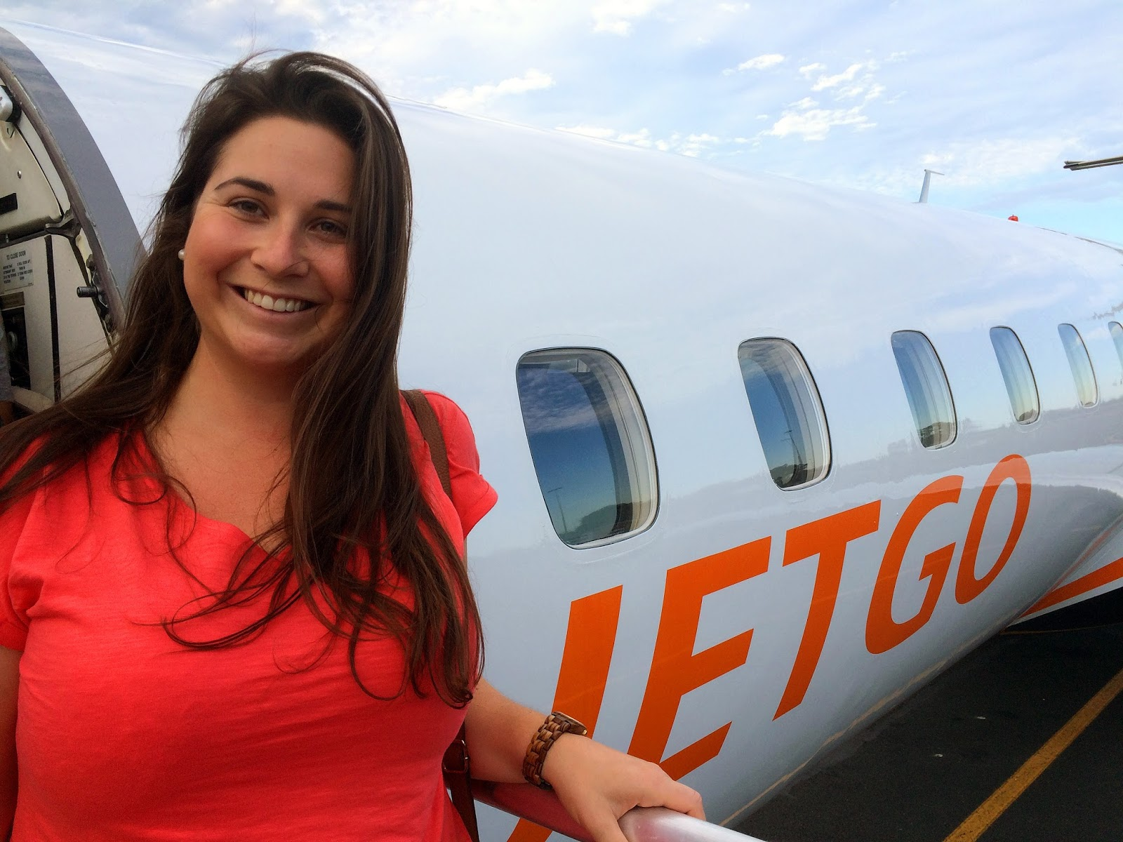 Girl boarding JETGO Australia Plane in Port Macquarie