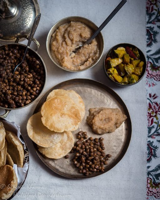 poori chana and halwa meal