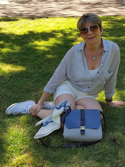 White shorts pared with sneakers, a blouse and vintage Pierre Cardin scarf, Furla hand bag