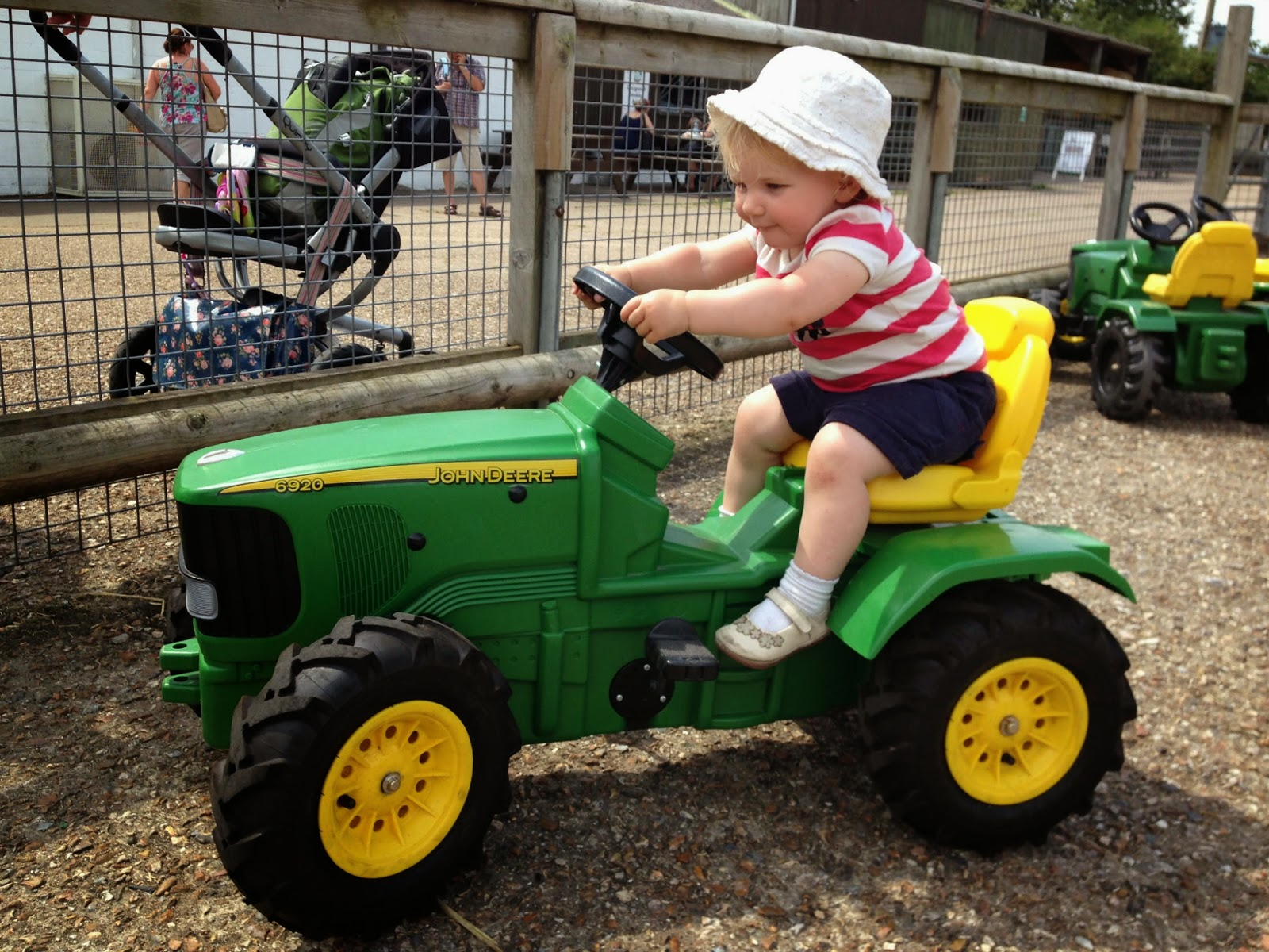 Tin Box Tot on a toy tractor