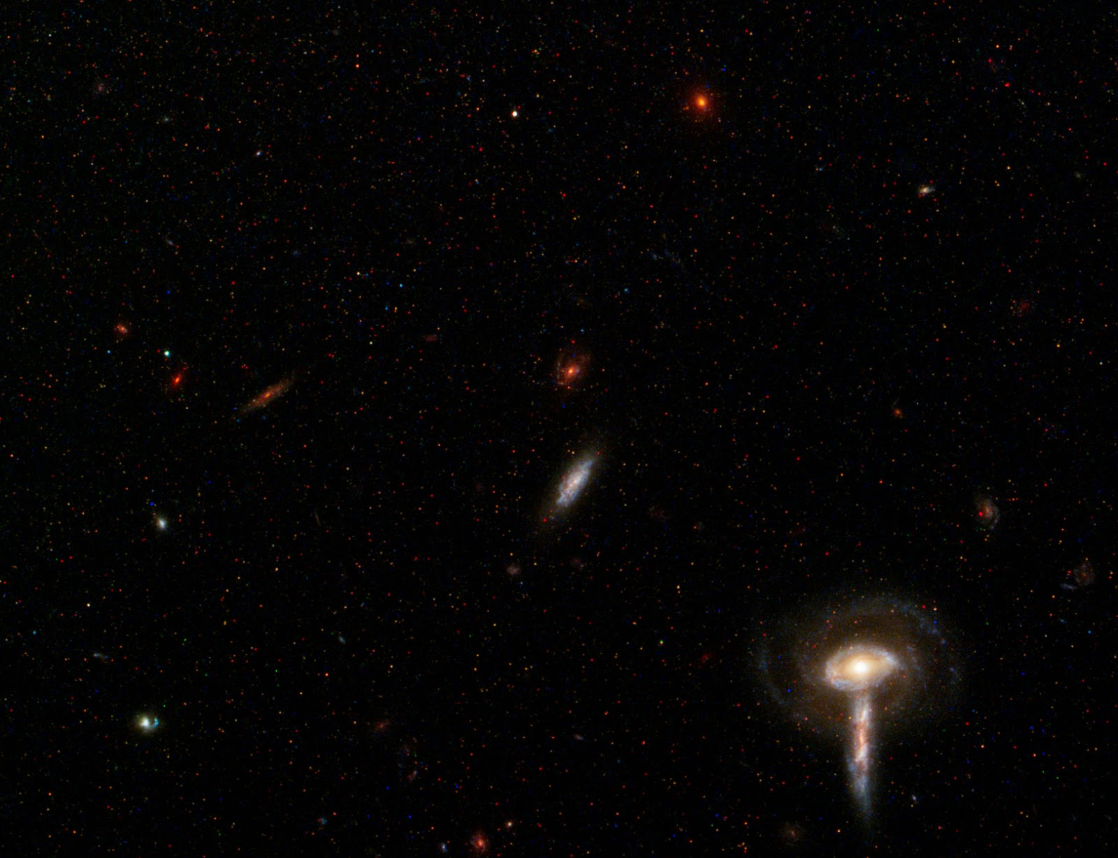 the history and background of galaxy Large disk galaxies like our own milky way were not always the well-ordered,   shown in red is the distant, background galaxy, being distorted by the   accumulate most of their gas during their first few billion years of history.