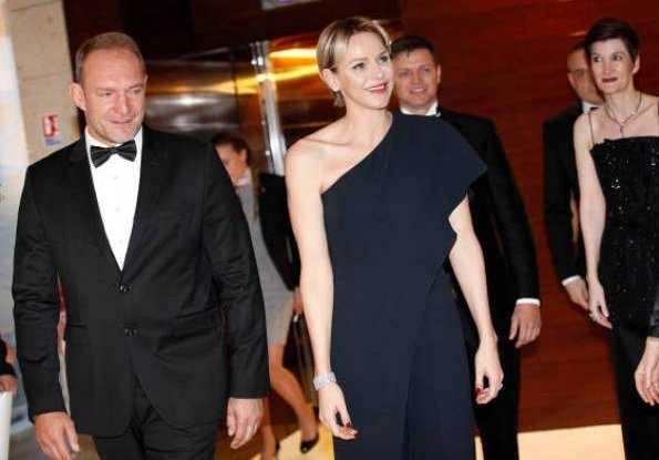 Princess Charlene wore Ralph Lauren Ruffle One shoulder Jumpsuit at the Monaco Yacht Club. The Princess Charlene of Monaco Foundation