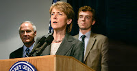 Former Massachusetts Attorney General Martha Coakley (D) is pictured in 2007 talking about the Supreme Court decision Massachusetts v. U.S. EPA. It set the stage for EPA's endangerment finding. Behind Coakley, from left to right, are former Massachusetts Attorney General Tom Reilly (D) and Frank Gorke, former director of Environment Massachusetts. (Credit: Charles Krupa/Associated Press) Click to Enlarge.