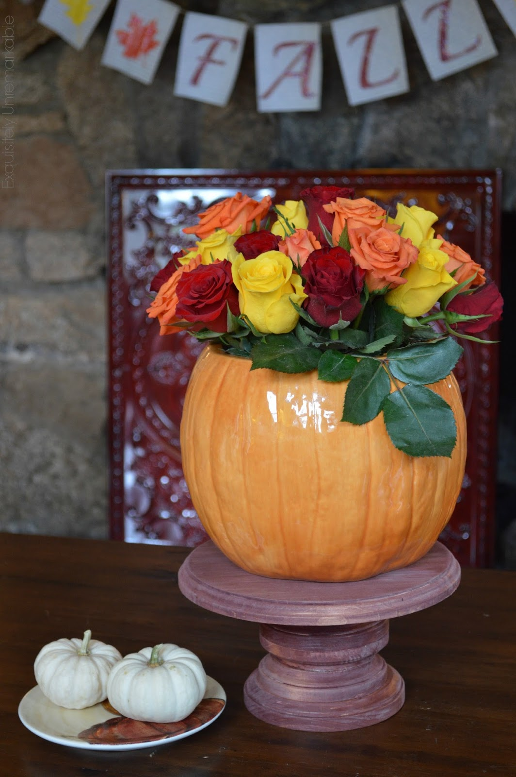 Fall floral arrangement set it pumpkin vase on wooden cake plate