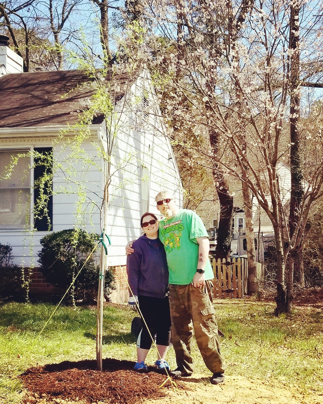 Caitlin And Hubby With The Memorial Willow Tree