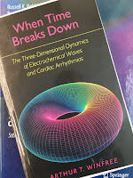 When Time Breaks Down, The Three-Dimensional Dynamics of Electrochemical Waves and Cardiac Arrhythmias, by Art Winfree, superimposed on Intermediate Physics for Medicine and Biology.