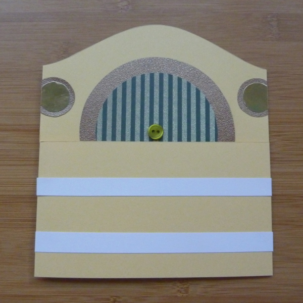 Laying white strips of paper across the greeting card front