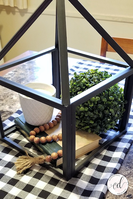 Farmhouse style lantern made from dollar store picture frames.