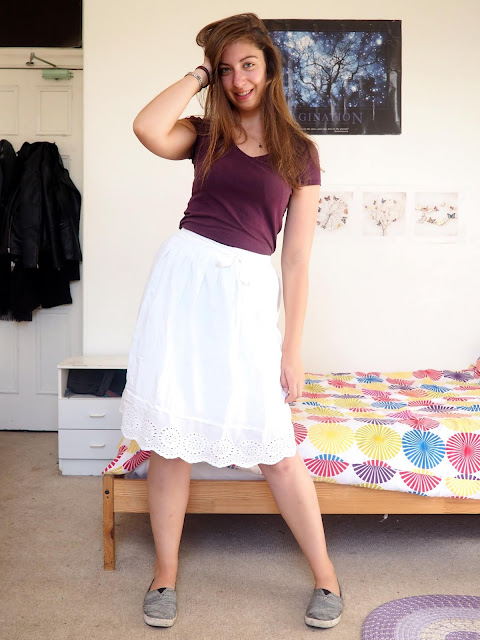 Aladdin inspired Disneybound outfit of dark purple top, long white skirt, and grey Toms shoes