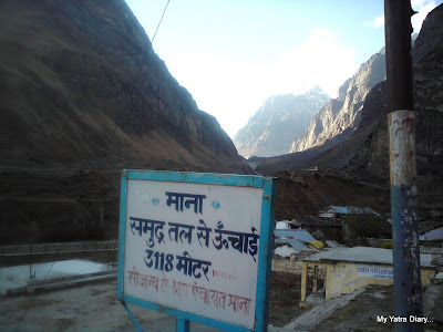 A board displaying the Height of Mana Village in the Himalayas
