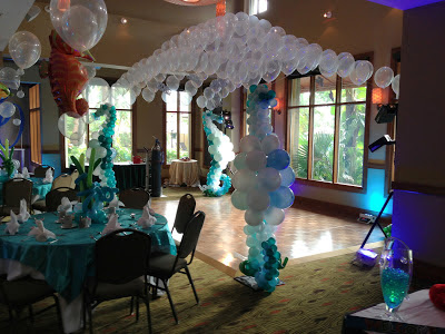 Dance floor decoration with balloon arch & seahorse balloon sculpture