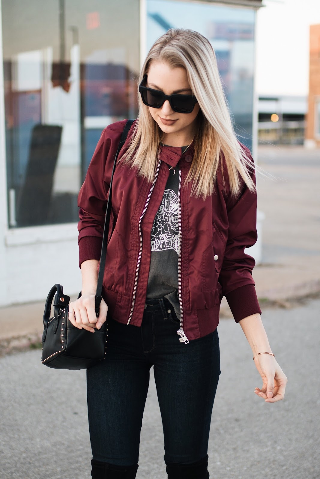 bomber jacket over a graphic tee