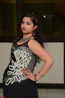 Shrisha Dasari in Sleeveless Short Black Dress At Follow Follow U Audio Launch 049.JPG