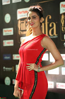 Meenakshi Dixit in Red One Shoulder Red Zipped up gown at IIFA Utsavam Award 70.JPG