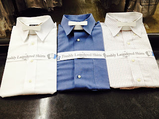 Three pressed, starched and laundered dress shirts