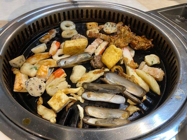 Meats and seafood on the grill at Tong Yang Shabu-Shabu