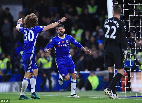 Diego Costa celebrates scoring his side's third goal along with David Luiz