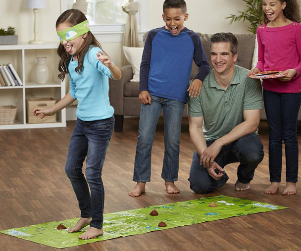 Turn an unpleasant experience into the highlight of family game night by gathering the kiddies for some fun with the Don't Step In The Poop game. Players must navigate through the poop infested game mat while blindfolded and avoid as many dookies as possible.