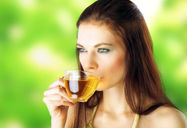 Beautiful Girl Drinking Healthy Ginger Tea