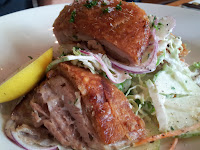 Crispy pork belly on apple and walnut coleslaw