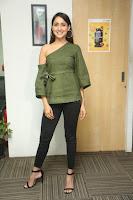 Pragya Jaiswal in a single Sleeves Off Shoulder Green Top Black Leggings promoting JJN Movie at Radio City 10.08.2017 079.JPG